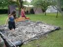 Préparation du torchis : argile, eau, paille, sable et terre